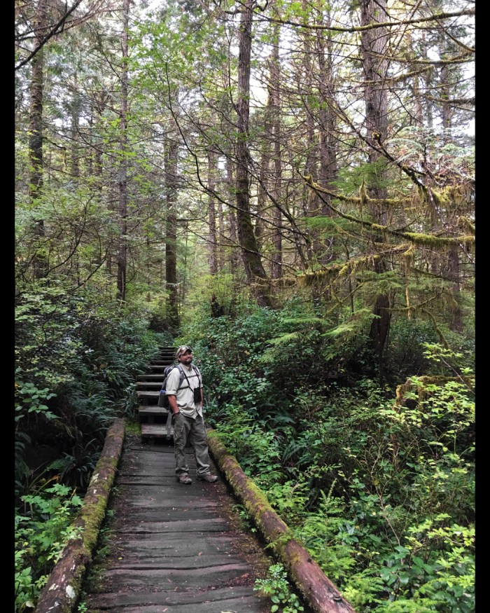 Michael standing on one of the boardwalks on Cape Alava Trail