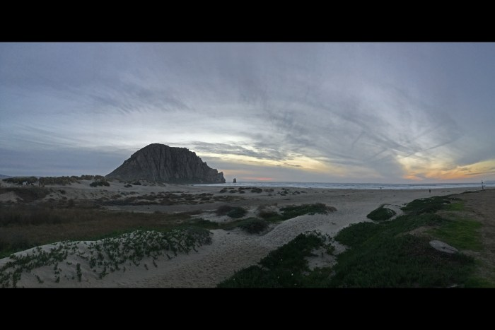 Scene from the beach at Morro Bay with Morro Rock and the ocean