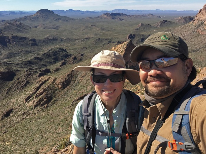 Selfie of Michael and Christina on the peak just above Bull Pasture with the expansive desert in the distance