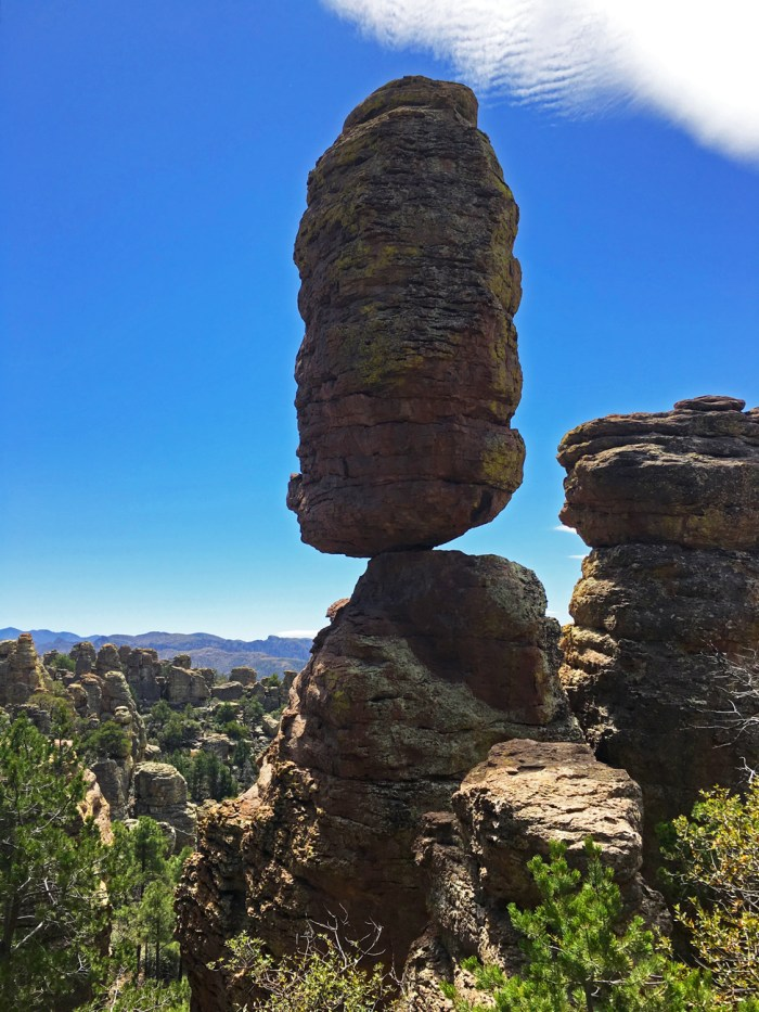 Tall rock precariously balanced on top of a pinnacle