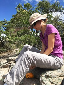 Christina sitting on a rock eating lunch at Chiricahua