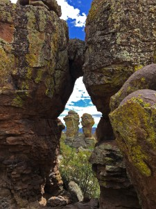 View between a couple of pinnacle to a pair of pinnacles in the distance that look like friends