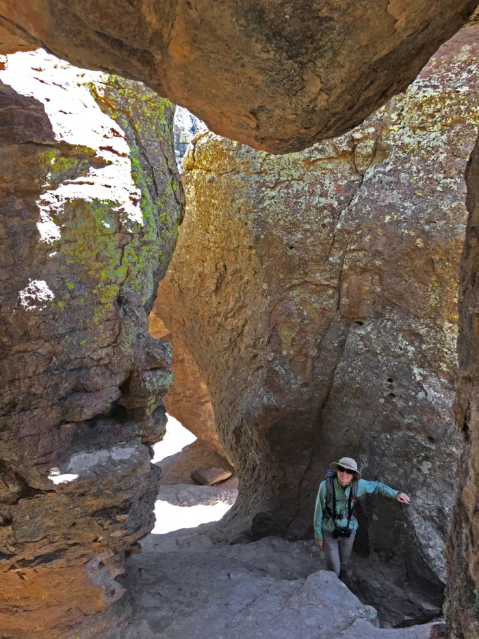 "Echo Canyon Grotto - a cave with several ""rooms"" formed by rocks with Christina standing against one of the rocks"