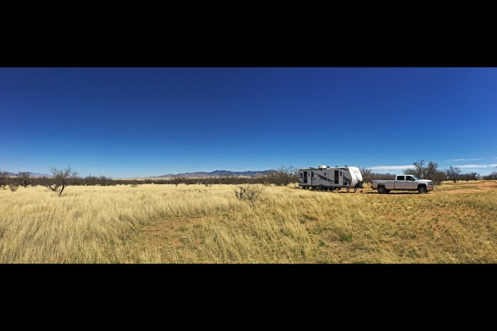 Our truck and trailer in our campsite at Las Cienegas surrounded by golden grasses and dormant mesquite shrubs