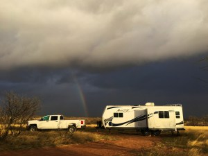 Black clouds and a rainbow over our campsite at Las Cienegas