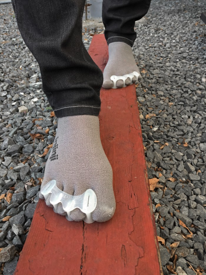 My feet in Injinji toe socks and Correct Toes toe spacers, walking in a straight line