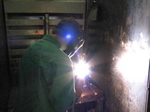 student welding metal
