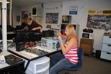 female student assembling a computer