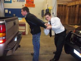 student handcuffing another student