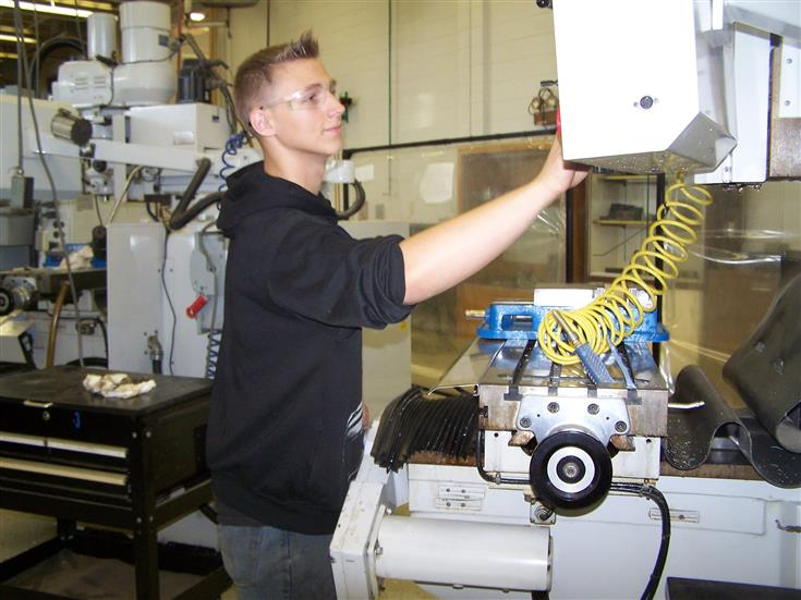 student operating a CNC