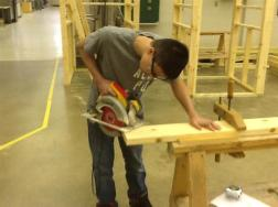 student using a circular saw