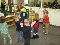 students dancing and clapping