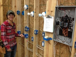 student splicing electrical boxes