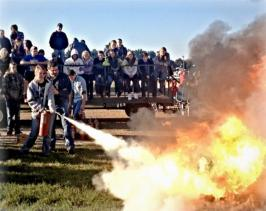 student putting out fire with extingisher