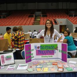 student selling greeting cards