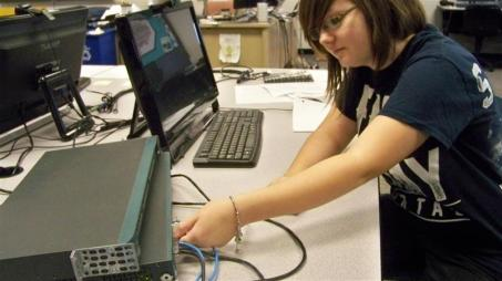 Female student plugging in a router