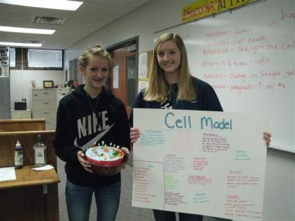 students posing with poster