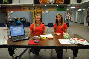 2 students taking registrations