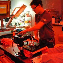 student ironing a shirt print