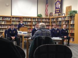 students in a mock meeting
