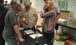 students problem solving at a table