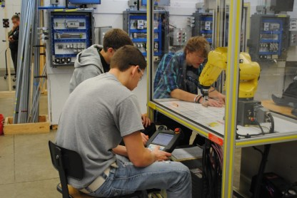 student aranging parts for robot