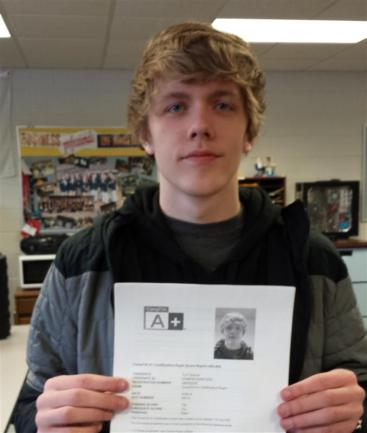 Student holding A+ certificate