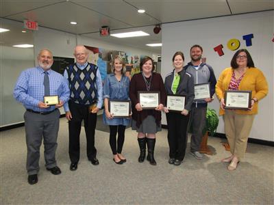 (left to right): Flip Johnson, Ron Sampsel, Stacy Winter, Jill Knaack, Kristen Smith, Andrew Gray and Ginger Kesler.