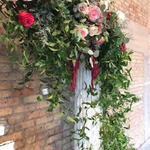 flower arch on vintage columns