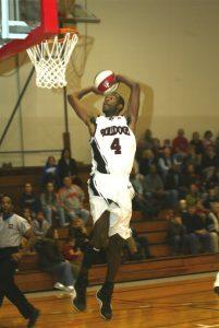 Elmira Bulldogs player shooting basketball
