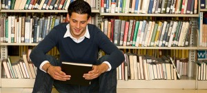boy and book in library