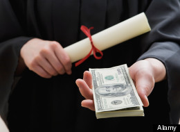 Graduate student holding money and diploma, mid section