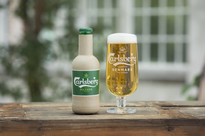 Carlsberg moves a step closer to creating the world's first 'paper' beer bottle. Pictured is a new research prototype for Carlsberg's Green Fibre Bottle, which contains beer for the first time.