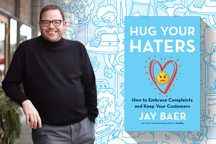 Jay Baer leaning on a planter box. The cover for the book: Hug Your Haters