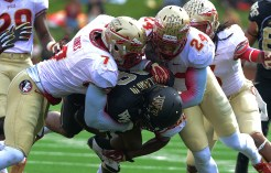 Christian Jones and Terrence Smith tackle.