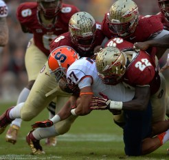 Defense swarms Syracuse's #27