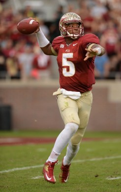 Jameis Winston aims and throws
