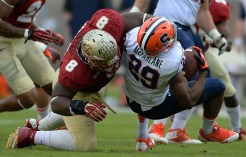 Tim Jernigan tackles the Syracuse running back