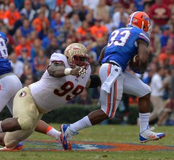 Nile Lawrence Stample reaches for the Gator running back