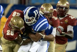PJ Williams and Terrence Smith stuff the Duke running play