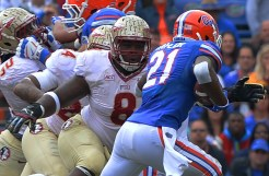 Tim Jernigan eyes the Florida ball carrier