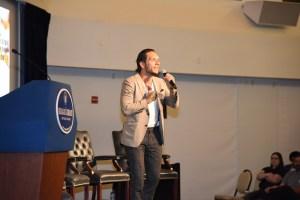 Brandon novak speaking at the DEA event