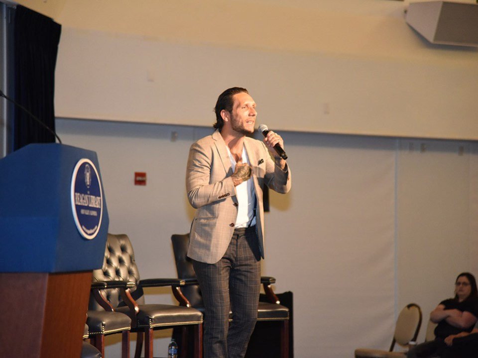 Brandon novak speaking at the DEA event