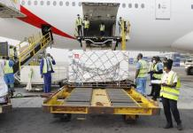 Vaccination COVID-19 vaccine doses shipped by the COVAX Facility head to Ghana, marking beginning of global rollout