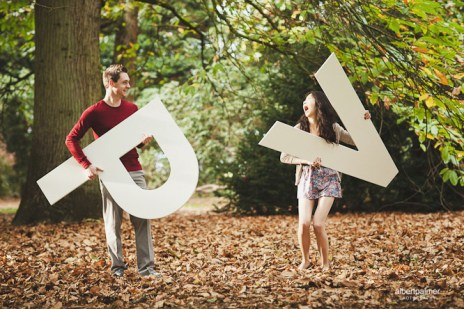 vanessa and phil being really funny with their engagement shoot props
