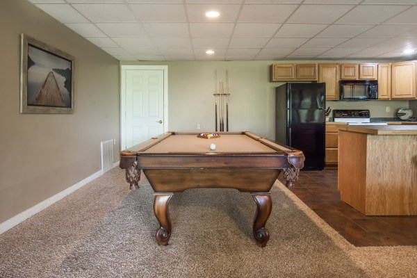 Hideaway Haven Branson Missouri vacation rental house family room with pool table and kitchen