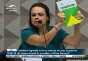 "Paschoal displaying her ""sacred book"", the 1988 Brazilian constitution."