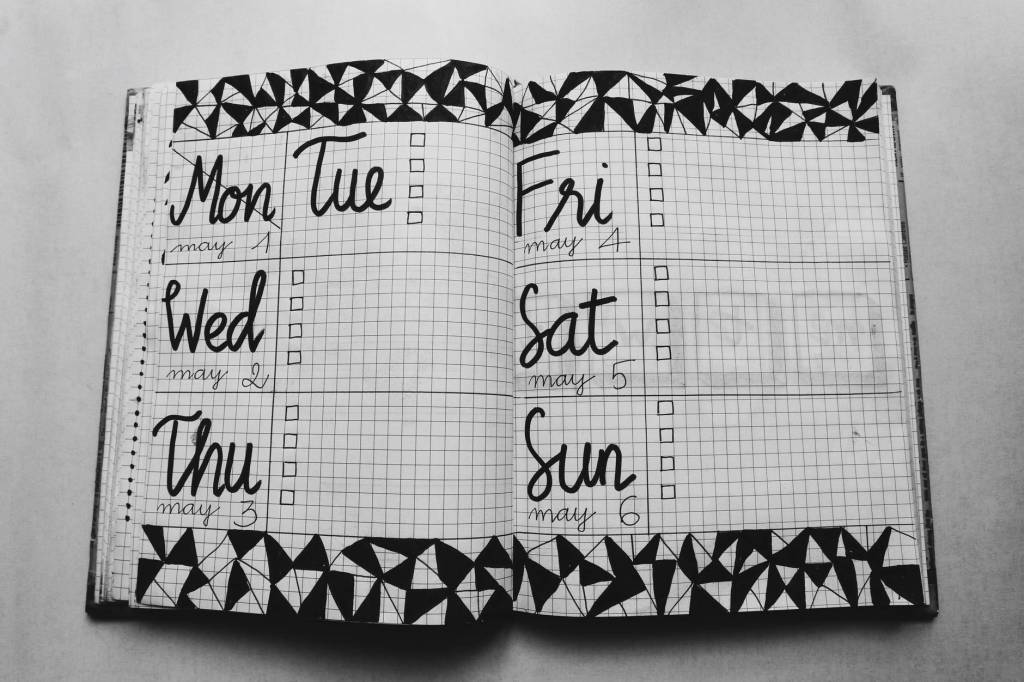 Investment Solutions - for Estate Planning  white and black weekly planner on gray surface