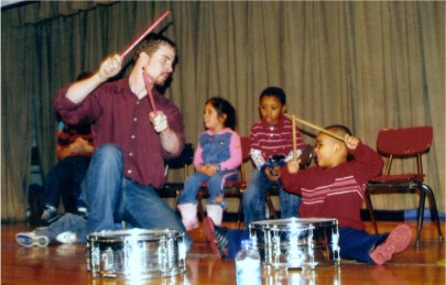 Playing drums with a student