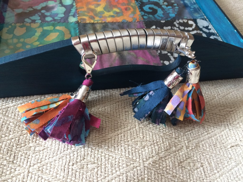 Closeup of removable tassels and faux leather handle wraps on boho tray